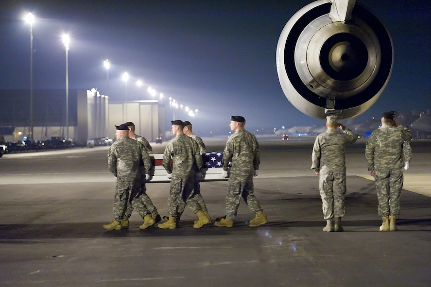 A U.S. Army carry team transfers the remains of Army Sgt. Aaron M. Arthur, of Lake City, S.C., at Dover Air Force Base, Del., March 10. Sgt. Arthur was assigned to 203rd Brigade Support Battalion, attached to the 1st Battalion, 10th Field Artillery Regiment, 3rd Brigade Combat Team, 3rd Infantry Division, Fort Benning, Ga. (U.S. Air Force photo/Roland Balik)