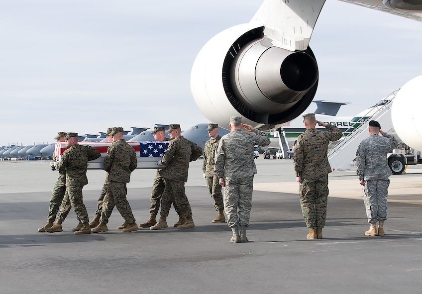 A U.S. Marine Corps team transfers the remains of Marine Corps Lance Cpl. Nigel K. Olsen, of Salem, Utah., at Dover Air Force Base, Del., on March 5, 2010. He was assigned to the 4th Light Armored Reconnaissance Battalion, 4th Marine Division, Marine Forces Reserve, Camp Pendleton, Calif. He died March 4 in Helmand province, Afghanistan, while supporting combat operations. (U.S. Air Force photo/Brianne Zimny)