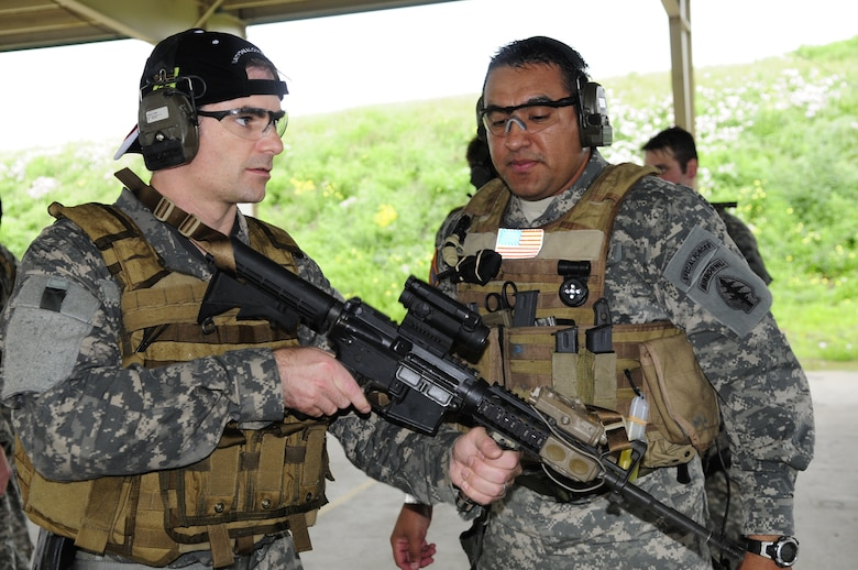NASCAR driver Jeff Gordon receives tips on weapons handling while suiting up with National Guard Security Forces Soldiers in Texas, on April 15, 2010. (U.S. Air Force photo by Senior Master Sgt. Mike Arellano/Released)