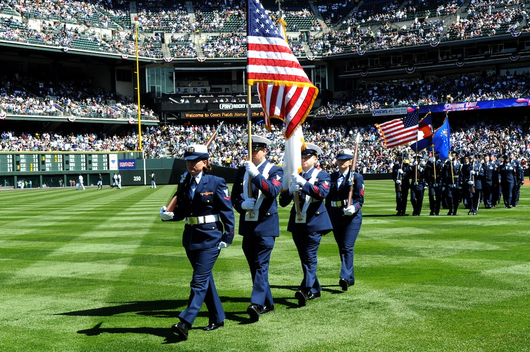 DENVER, Colo. -- Coast Guardsmen from Colorado recruiting stations and Buckley Air Force Base perform for a crowd of 45,509 people during Colorado Rockies Opening Day April 9 at Coors Field. (U.S. Air Force photo by Airman 1st Class Marcy Glass)