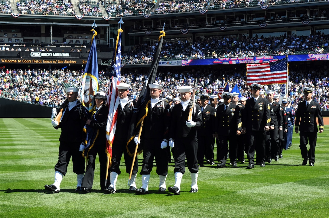 DENVER, Colo. -- Sailors of the Navy Recruiting District Denver and Buckley Air Force Base march with pride from Coors Field and a crowd of 45,509 people April 9. (U.S. Air Force photo by Airman 1st Class Marcy Glass)