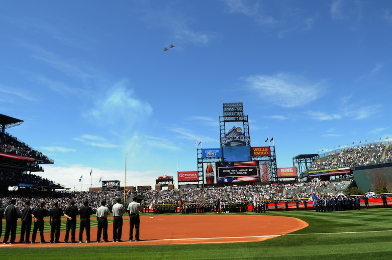 DENVER, Colo. -- A crowd of 45,509 people watch two Navy EA-18G Growlers fly over Coors Field during Colorado Rockies Opening Day April 9. The Rockies won the opener against the San Diego Padres 7-0. (U.S. Air Force photo by Airman 1st Class Marcy Glass)