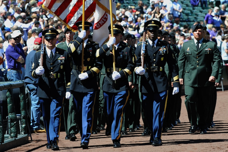 DENVER, Colo. -- Soldiers from Colorado recruiting stations and Fort Carson display the colors during the Colorado Rockies Opening Day festivities April 9 at Coors Field. (U.S. Air Force photo by Airman 1st Class Marcy Glass)