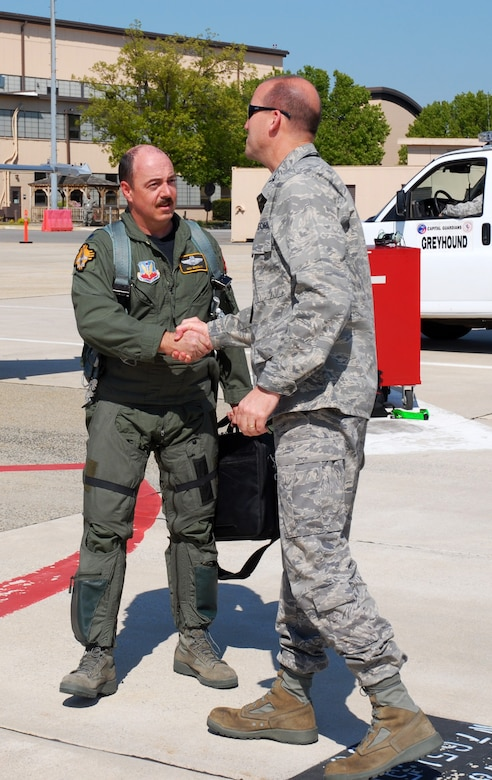 Col. Andrew Donnelly, 113WG Maintenance Group Commander, greets Lt. Col. Ben Breslin, New Mexico Air National Guard, who delivered a newer F-16 from New Mexico to its new home with the DC Air National Guard, April 15. (U.S. Air Force photo by Tech. Sgt Tyrell Heaton/Released)