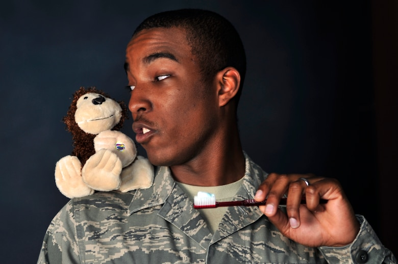 """BUCKLEY AIR FORCE BASE, Colo. -- In the spirit of Earth Day April 22, Team Buckley has chosen a """"Top 10"""" list of things to do to decrease our carbon footprint. Turn off the water when brushing your teeth. This will save eight gallons of water a day. Remember, saving the Earth is easy. It's so easy a monkey can do it.  (U.S. Air Force photo by Staff Sgt. Kathrine McDowell)"""