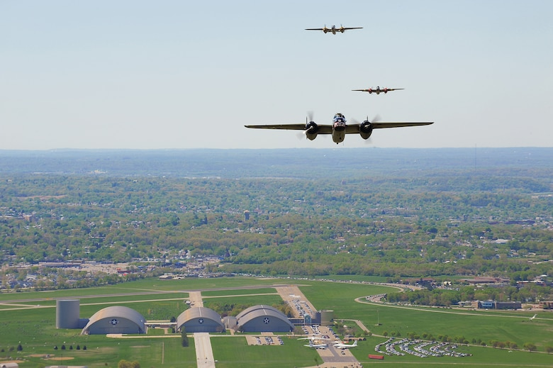 Vintage B-25 Mitchell bombers fly over the National Museum of the U.S. Air Force at Wright-Patterson Air Force Base, Ohio, during a memorial flight honoring the Doolittle Tokyo Raiders on April 18, 2010.  The 68th Doolittle Raiders' reunion commemorates the anniversary of the Doolittle Tokyo Raid.  On April 18, 1942, U.S. Army Air Forces Lt. Col. Jimmy Doolittle's squad of 16 B-25 Mitchell aircraft bombed Japanese targets in response to the attack on Pearl Harbor. (U.S. Air Force photo/Tech. Sgt. Jacob N. Bailey)