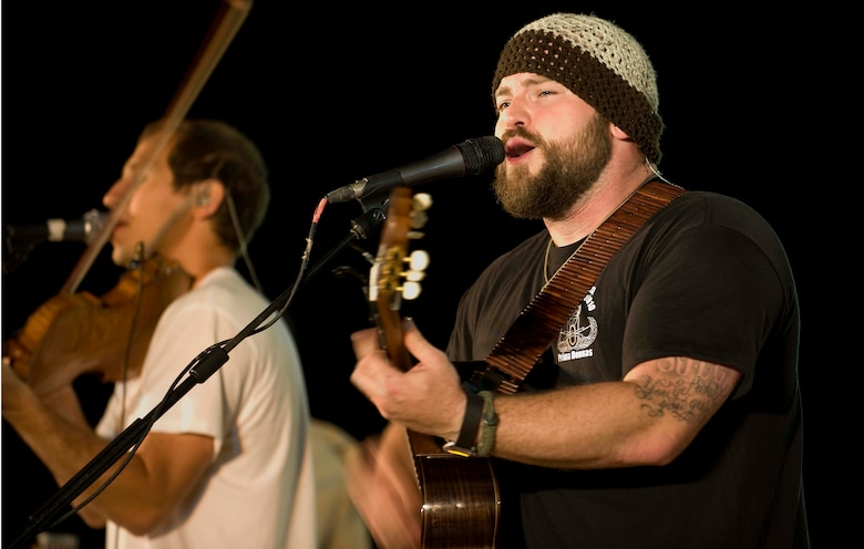 Zac Brown and his band perform for a crowd of deployed personnel in Holt Stadium at Joint Base Balad, Iraq, April 18, 2010. The Grammy nominated band is touring various bases throughout Southwest Asia to perform for the troops rather than attend this year's Academy of Country Music Awards for which they were nominated. (U.S. Air Force photo by Master Sgt. Linda C. Miller/Released)