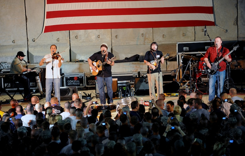 Members of the Zac Brown Band perform for a crowd of deployed personnel at Holt Stadium at Joint Base Balad, Iraq, April 18, 2010. The Grammy-nominated band is touring various bases throughout Southwest Asia to perform for the troops rather than attend this year's Academy of Country Music Awards for which they were nominated for several awards. (U.S. Air Force photo by Master Sgt. Linda C. Miller/Released)