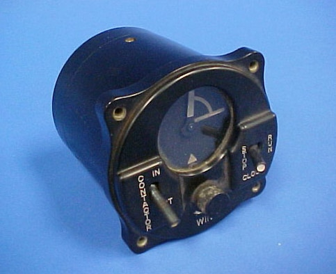 Installed in Allied aircraft as part of the Identification, Friend or Foe (IFF) program during World War II, this system would send a signal for 14 seconds of every minute over the pilot's radio to the ground station. The pilot could not speak while the unit was broadcasting. Designed to fit in a standard gauge slot, it has two switches (contactor in or out and clock stop or run), has one small knob (wind), and has clock face that indicates the time the unit is broadcasting. (U.S. Air Force photo)
