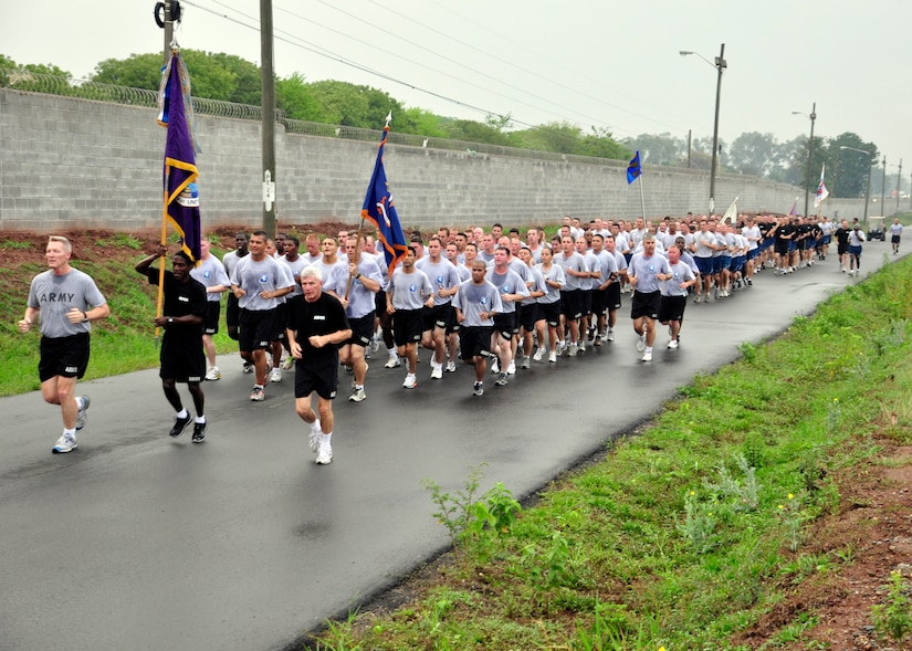 Joint Task Force-Bravo members participate in a monthly base run April 20 to build camaraderie and promote fitness across the different units at Soto Cano Air Base, Honduras. Army Col. Gregory Reilly, JTF-Bravo Commander, also took time to commend the Airmen, Soldiers, Sailors and Marine on the job they have been doing carrying out the mission of JTF-Bravo. (U.S. Air Force photo by Staff Sgt. Bryan Franks)