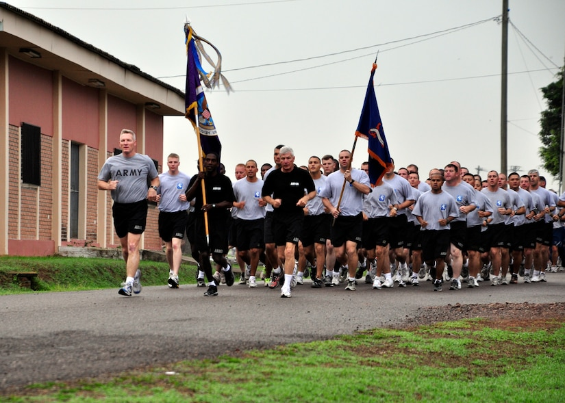 Members of Joint Task Force-Bravo take part in a monthly base run April 20 to build camaraderie and promote fitness across the different units at Soto Cano Air Base, Honduras. Col. Gregory Reilly, JTF-Bravo Commander, also took time to speak to the Airmen, Soldiers, Sailors and Marine and tell them how proud he was of the work they have accomplished. (U.S. Air Force photo by Staff Sgt. Bryan Franks)
