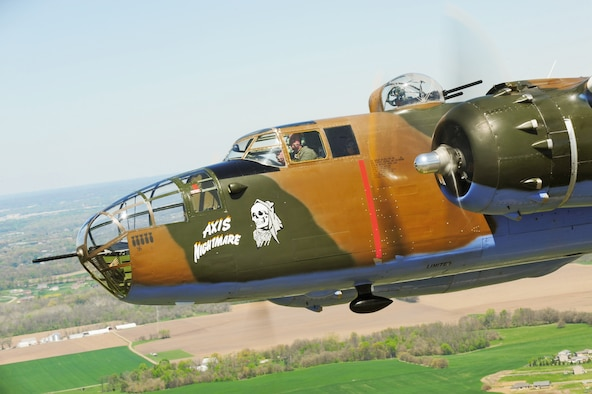 A vintage B-25 Mitchell bomber flies near the National Museum of the U.S. Air Force at Wright-Patterson Air Force Base, Ohio, April 18, 2010, during a memorial flight honoring the Doolittle Raiders. (U.S. Air Force photo/Tech. Sgt. Jacob N. Bailey)