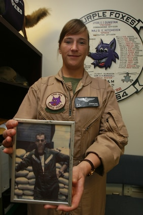 """Capt. Eileen C. Donovan, a CH-46E pilot with Marne Medium Helicopter Squadron 166, Marine Aircraft Group 16, 3rd Marine Aircraft Wing, visited HMM-364 April 21, where they still have a portrait of her father Jospeh P. Donovan, in the ready room. Eileen's father served as pilot with HMM-364 also known as the """"Purple Foxes"""" during the Vietnam War. ::r::::n::(Official U.S. Marine Corps photo by Cpl. Christopher O'Quin/Released)"""