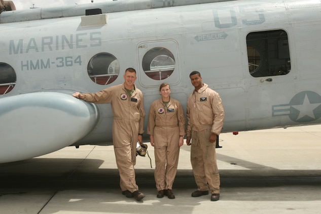 """Capt. Eileen C. Donovan (Center) a CH-46E """"Sea Knight"""" pilot with Marine Medium Helicopter Squadron 166, Marine Aircraft Group 16, 3rd Marine Aircraft Wing, joined friend and pilot Capt. Elijah L. Stevenson (Left) and Lance Cpl. Alexander Avery (Right) a crew chief, both with Marine Medium Helicopter Squadron 364, for a commorative flight over Camp Pendleton, April 21. Donovan recently returned from deployment with the 11th Marine Expeditionary Unit and enjoyed the chance to practice landing on solid ground. ::r::::n::(Official U.S. Marine Corps photo by Cpl. Christopher O'Quin/Released)"""