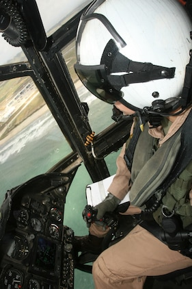 """Capt. Eileen C. Donovan, a CH-46E """"Sea Knight"""" pilot with Marine Medium Helicopter Squadron 166, Marine Aircraft Group 16, 3rd Marine Aircraft Wing, flies while visiting Marine Medium Helicopter Squadron 364, April 21. She performed landings and take-offs for the hour flight on the 41st anniversary of her father Joseph P. Donovan's casevac mission in Vietnam. ::r::::n::(Official U.S. Marine Corps photo by Cpl. Christopher O'Quin/Released)"""