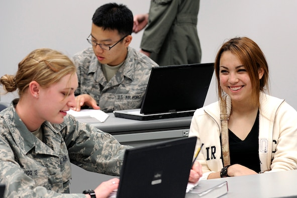 Cadet 4th Class Kathryn Bugg from Cadet Squadron 40 and Stacey Wilkens share a laugh during a class here Tuesday. Ms. Wilkens, a native of San Antonio, visited as part of the Class of 2014 Appointee Orientation Monday and Tuesday. (U.S.  Air Force photo/Mike Kaplan)