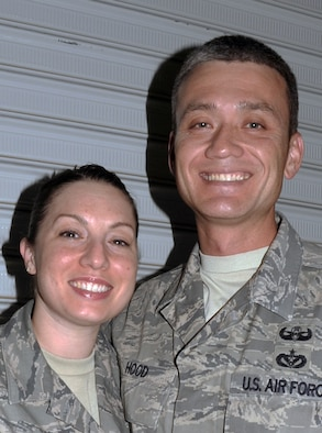 Tech. Sgt. Wendy Hood, a command post craftsman with the 380th Air Expeditionary Wing, stops for a photos with her husband, Tech. Sgt. Robert Hood, an explosive ordnance technician with the 380th Expeditionary Civil Engineer Squadron, at a non-disclosed base in Southwest Asia on April 21, 2010. They are both deployed together for the first time and celebrated their 10th wedding anniversary on April 22. Both of the Sergeants Hood are deployed from Hill Air Force Base, Utah. Sergeant Robert Hood is from the 775th Civil Engineer Squadron and his hometown is Killeen, Texas. Sergeant Wendy Hood is from the 75th Air Base Wing Command Post and her hometown is Hooksett, N.H. (U.S. Air Force Photo/Master Sgt. Scott T. Sturkol/Released)