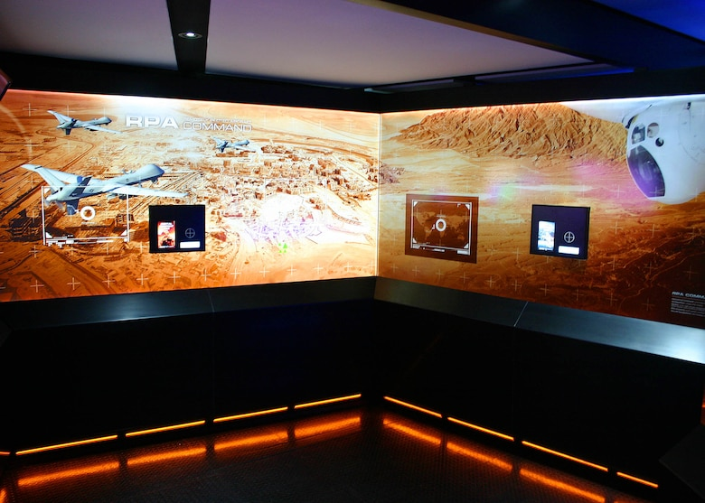 "Command Center Alpha is the Air Force's newest mobile marketing tour. A first-of-its-kind augmented reality mobile tour experience, Command Center Alpha immerses visitors in the ""sci-fi"" world of the U.S. Air Force. The interactive tour includes 3-D computer graphics, videos, educational kiosks, digital downloads and a full-size F-16 Thunderbird display. (U.S. Air Force photo/Dale Eckroth)"