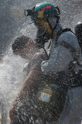 NEW YORK -- A FDNY firefighter sprays water on simulated victims of a chemical attack in the subway, as Marines from the Chemical Biological Incident Response Force (CBIRF) lead them out of the subway, at FDNY Fire Academy on Randall's Island, N.Y, April 22. FDNY and Marines from the Chemical Biological Incident Response Force (CBIRF) joined together for a training exercise after a weeklong training evolution between the two units.  (Official Marine Corps photo by Sgt. Randall A. Clinton / RELEASED)