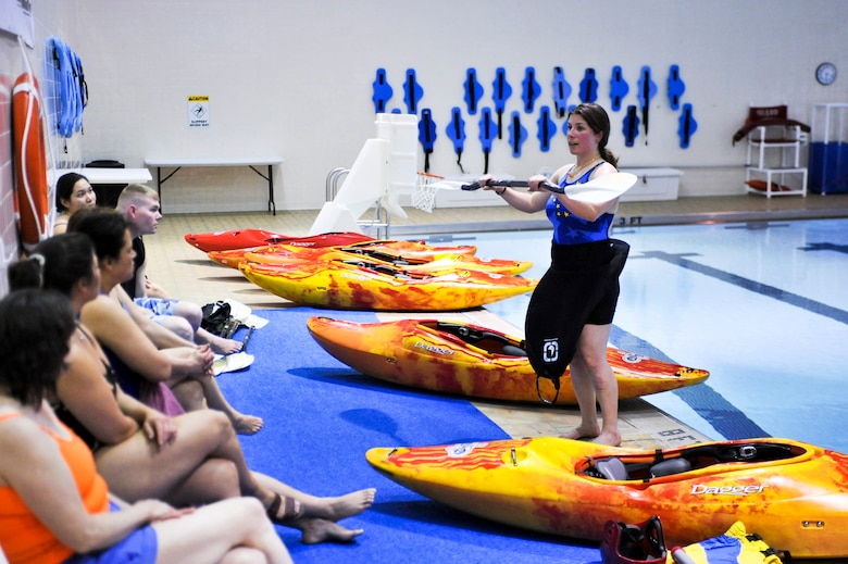ELMENDORF AIR FORCE BASE, Alaska -- Raina Panarese, director of Elmendorf's Outdoor Adventure Program, talks to a group of participants taking her kayak safety class April 22. The class helped prepare participants to react to kayak mishaps. Kayak safety classes are required for anybody renting kayaks from Elmendorf's Outdoor Recreation Center, or for anybody attending one of OAR's kayaking trips. (Air Force photo by Airman 1st Class Christopher Gross)
