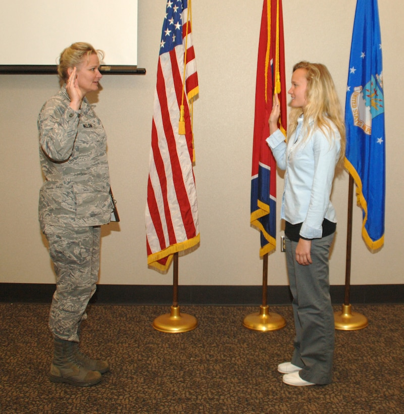 Maj. Lawana Nelson, Director of Personnel at the 118th Airlift Wing, administers the Oath of Office to her daughter, Lauren Lavery, April 20, formally swearing her into the Tennessee Air National Guard.