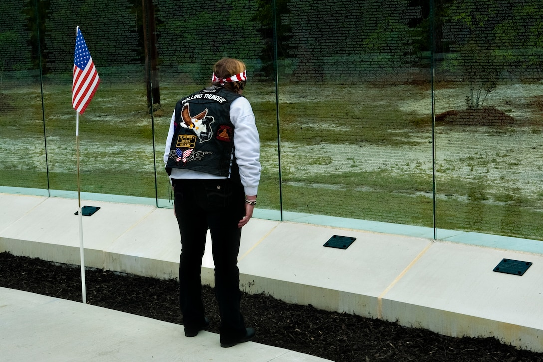 A member of the NC-5 chapter of Rolling Thunder, an organization for Vietnam War veterans, looks upon the walls of the Vietnam Veterans Memorial portion of the Lejeune Memorial Gardens after the Vietnam Recognition Day, April 24. The event is in remembrance of all Vietnam veterans and the mental and physical scars they live with every day.