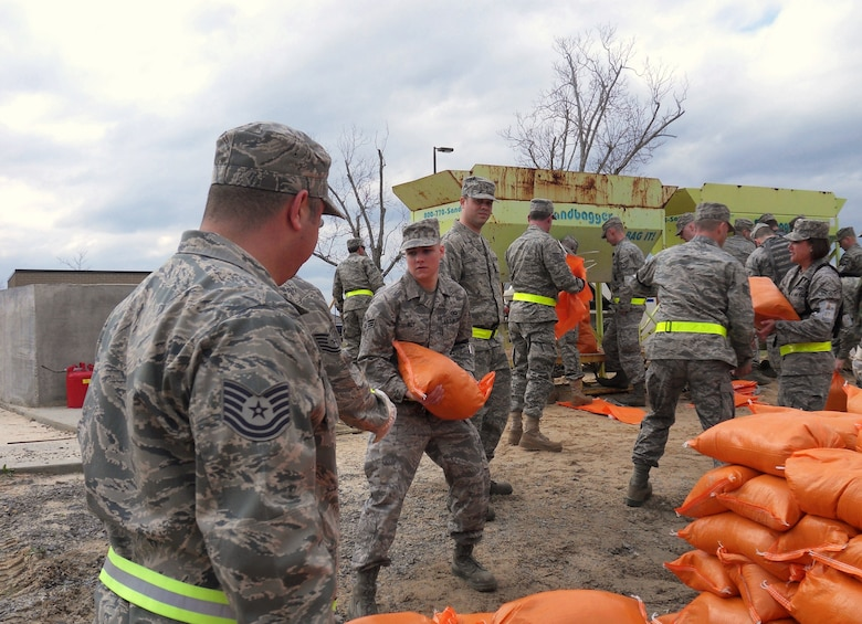 Members of the Kentucky Air National Guard fill sandbags at the Gulfport Combat Readiness Training Center in Gulfport, Miss., on March 21, 2010. The Guard members and Airmen from two other Air Force units provided theater airlift services in support of a simulated G8 Summit in New Orleans. (U.S. Air Force photo/Tech. Sgt. Dennis Flora)