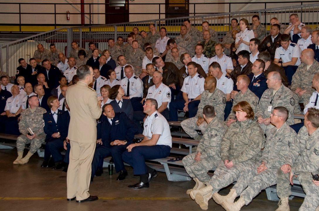 Admiral Mike Mullen, Chairman of the Joint Chiefs of Staff, conducted a Town Hall meeting with members of the 140th Wing, Colorado Air National Guard Monday.  During the meeting, members of the Air National Guard posed questions concerning the future of the Guard.  Picture here, Lt. Col. Gina Simonson, 140th Wing Staff Judge Advocate, poses a question regarding plans to include Title 32 members in the post 9/11 G.I. Bill.  (U.S. Air Force Photo/SMSgt John Rohrer) ( RELEASED)