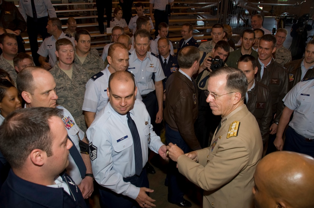 Admiral Mike Mullen, Chairman of the Joint Chiefs of Staff conducted a Town Hall meeting with members of the 140th Wing, Colorado Air National Guard Monday, 26 April 2010.  During the meeting, members of the Air National Guard posed questions concerning the future of the Guard.  Picture here, Admiral meets members of the 140th Wing and presents MSgt Gregory Elrod, 140th Security Forces Squadron, and others with a coin as a token of his appreciation for their service.  (U.S. Air Force Photo/SMSgt John Rohrer) ( RELEASED)
