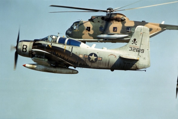A-1E Skyraider escorts an HH-3C rescue helicopter on a CSAR mission in 1966. (U.S. Air Force photo)
