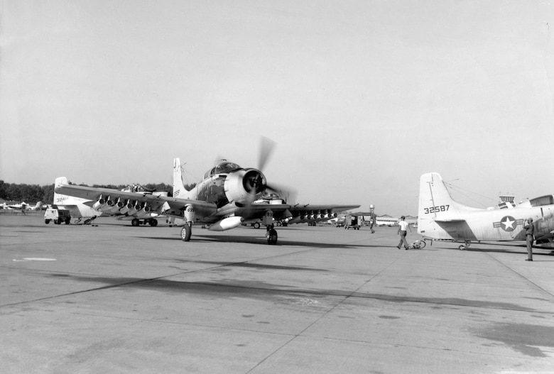 A Vietnamese Air Force student pilot and a USAF instruction sit side by side in a VNAF A-1E Skyraider taxing to the runway at Bien Hoa AB, Vietnam. (U.S. Air Force photo)