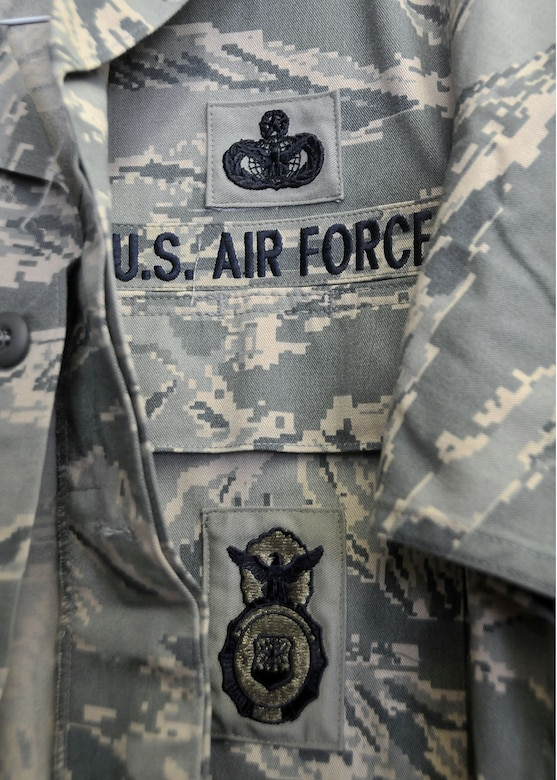 "For every uniform, Billerbeck sews on two rank insignias on the sleeves, the name tape above the right chest pocket, the ""US AIR FORCE"" tape above the left chest pocket and in some cases the functional badges specific to each job duty (AFSC)."