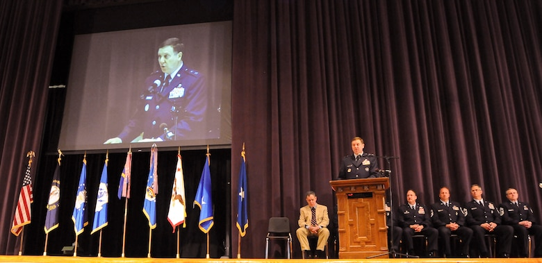 Kentucky's adjutant general, Maj. Gen. Edward Tonini, describes the contributions of the more than 900 members of the Kentucky Air National Guard who have deployed world wide for combat operations since Sept. 11, 2001 during a Hometown Heroes ceremony held April 17, 2010 at Louisville Male High School in Louisville, Ky. (U.S. Air Force photo/Tech. Sgt. Dennis Flora)