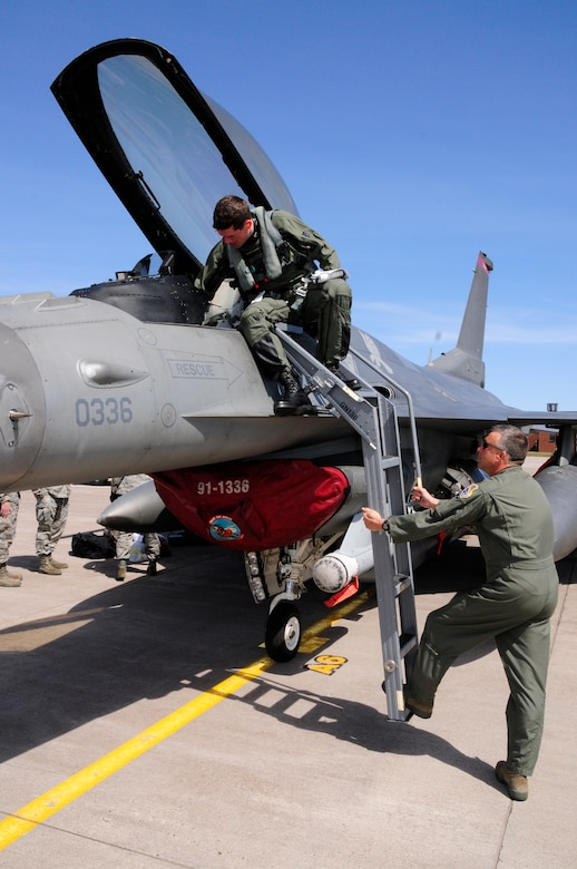 U.S. Air Force Colonel John Spencer, Jr., Vice Wing Commander, greats Maj. Matt Gynn as F-16C Block 50 Fighting Falcons from Spangdahlem Air Base, Germany arrive at the 148th Fighter Wing Air National Guard Base, Duluth, Minn. Apr. 27, 2010. The aircraft is one of the first block 50 F-16s to arrive at the wing as the unit becomes the first Air National Guard unit to convert to the block 50 aircraft from Active Duty Air Force.  (U.S. Air Force photo by Tech. Sgt. Brett R. Ewald/Released)