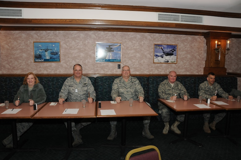 The esteemed panel of judges from (left to right)  Lt. Col. Linda Blaszak, Col. Timothy Vaughan, Lt. Colonels Barry Griffith, and Patrick Roemer, and Master Sgt. Randall Shenefiel eagerly await their meal. (U.S. Air Force photo/Staff Sgt. Peter Dean)