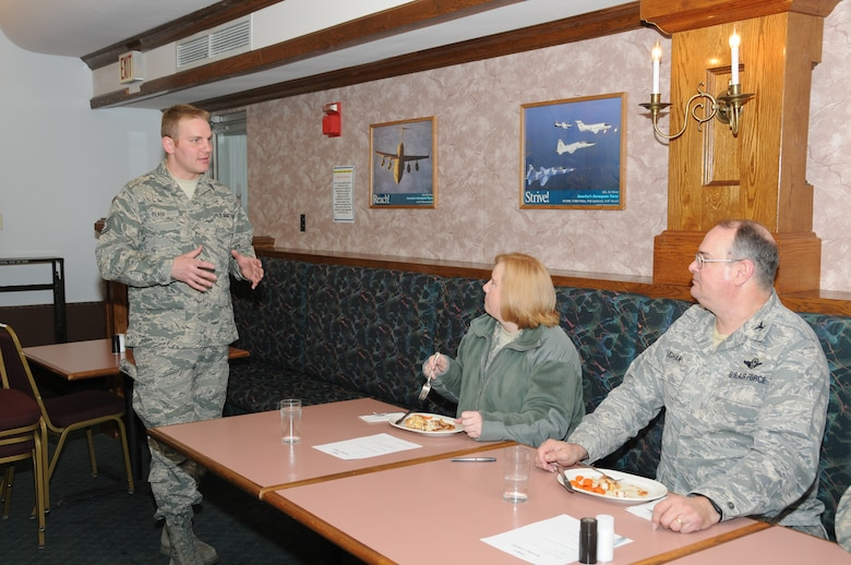 "Tech. Sgt. Stephen Pease the dining hall supervisor explains to judges Lt. Col. Linda Blaszak the 107th Force Support Squadron Commander and Col. Timothy Vaughan the 107th Mission Support Group Commander the concept behind the food challenge. ""We have done really well in our inspections. These guys have worked cohesively as a team and it is almost a family atmosphere.  At this time what we wanted to do was challenge them. This was a chance to get them to step it up,"" Sgt. Pease said. (U.S. Air Force photo/Staff Sgt. Peter Dean)"