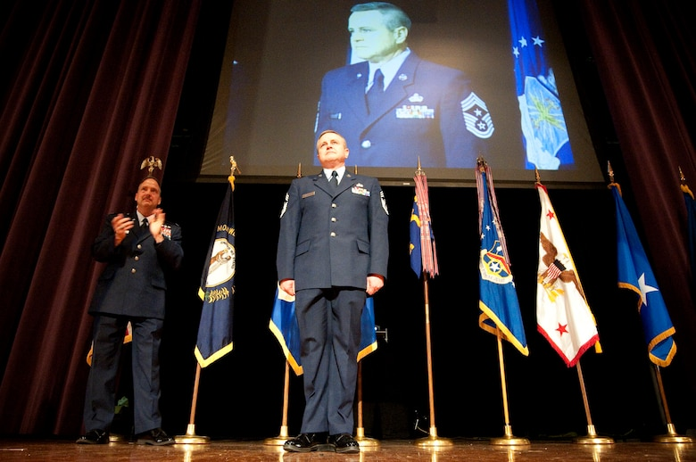The Kentucky Air Guard welcomed its newest 123rd Airlift Wing command chief master sergeant, Chief Master Sgt. Curtis Carpenter (right), during a change-of-responsibility ceremony held April 17, 2010 at Louisville Male High School in Louisville, Ky. Also pictured is Col. Greg Nelson, commander of the 123rd Airlift Wing. (U.S. Air Force photo/Senior Airman Maxwell Rechel)