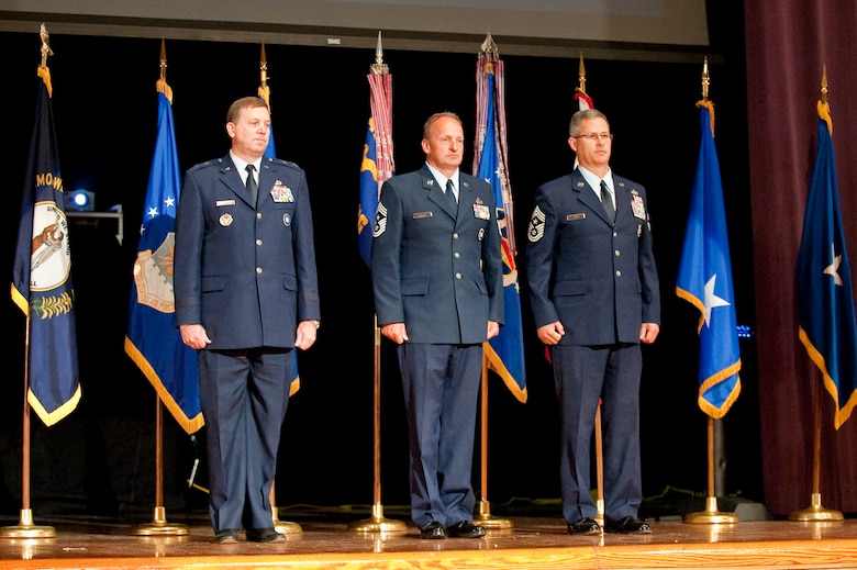 The Kentucky Air Guard welcomed its newest state command chief master sergeant, Chief Master Sgt. James Smith (right), during a change-of-responsibility ceremony held April 17, 2010 at Louisville Male High School in Louisville, Ky. Also pictured are Kentucky's adjutant general, Maj. Gen. Edward Tonini (left) and former State Command Chief Master Sgt. Mark Grant (center), who is retiring from the Kentucky Air Guard after 30 years of service. (U.S. Air Force photo/Maj. Dale Greer)