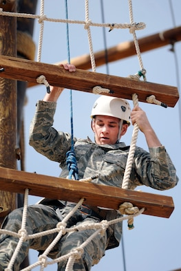 "Second Lt. Joshua Meents navigates the Ropes Course at the U.S. Air Force Academy April 15, 2010. Lieutenant Meents visited the Academy to speak at the Spring 2010 Falcon Heritage Forum, which was themed, Officers of Character: Lieutenants in Action."" He is assigned to the 53rd Electronic Warfare Group, Detachment 1, at Nellis Air Force Base, Nev. (U.S. Air Force photo/Bill Evans)"