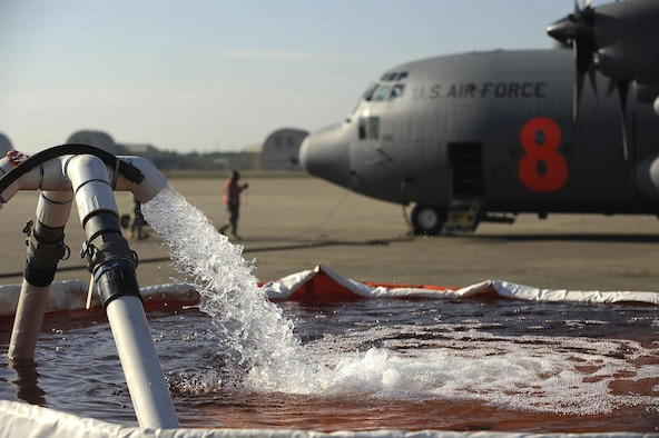 An inflatable tub is filled with water that will be pumped into a C-130