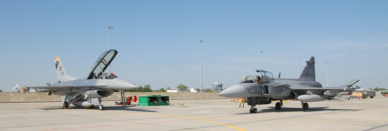 KECSKEMET, Hungary -- A 178th Fighter Wing F-16 Fighting Falcon and a Hungarian Air Force JAS- 39 Gripen during the Load Diffuser Exercise 2010 in Kecskemet, Hungary April 29. The exercise aims to sharpen the combat capabilities of the participating forces by conducting a 10 to 15 day flying program.