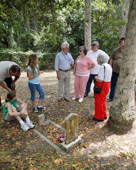 Family members visit the gravesite of Miles Burnham, the first Cape Canaveral Lighthouse keeper during the Descendents Reunion April 24. Accompanying them is Detachment 1, 45th Mission Support Group Director of Operations Sonny Witt (center in blue shirt). (U.S. Air Force photo/Nancy Watts)