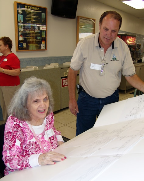 Canaveral Rose Koontz looks over her family tree with son Ed Lipsey at the Descendents Reunion in the Cape Cafeteria April 24. At 85, Canaveral Rose was one of the oldest reunion participants. (U.S. Air Force photo/Nancy Watts)
