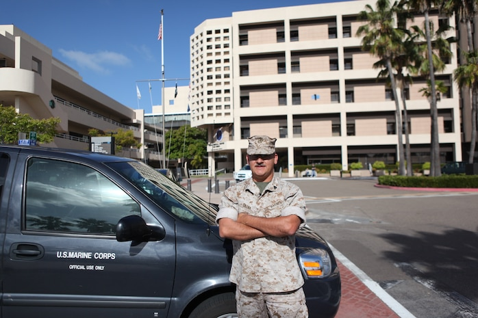 Sgt. George Gaona, a driver for the Wounded Warrior Battalion from La Puente, Calif., waits for a fellow Marine at the Balboa Naval Hospital. Due to a past injury, Gaona volunteered to work at the Wounded Warrior Battalion and help his fellow Marines as a driver, transporting them to and from medical appointments. (U.S. Marine Corps photo by Lance Cpl. John M. McCall)