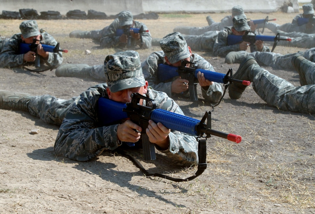 LACKLAND AIR FORCE BASE, Texas -- Trainees from 326th Training Squadron practice getting into the prone position during combat skills training in July Lackland Air Force Base, Texas. The 37th Training Wing, Lackland Air Force Base, San Antonio, Texas, is the largest training wing in the Air Force. The 37th TRW provides basic military, professional and technical skills, and English language training for the Air Force, other military services, government agencies, and our allies. Lackland's four primary training functions graduate more than 86,000 students annually. These four missions include basic military training of all enlisted people entering the Air Force, Air Force Reserve and Air National Guard; technical training; English language training; and specialized maintenance and security training. (U.S. Air Force photo Senior Airman Nicole Roberts)