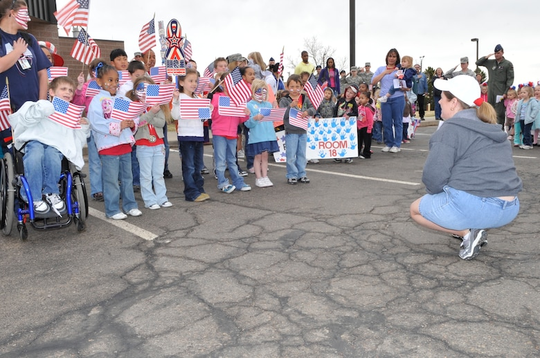 """BUCKLEY AIR FORCE BASE, Colo. -- Crested Butte Child Development Center pre-school children perform """"Yankee Doodle"""" at the Month of the Military Child kick-off March 31 for their parents and loved ones. (U.S. photo by Airman 1st Class Paul Labbe)"""