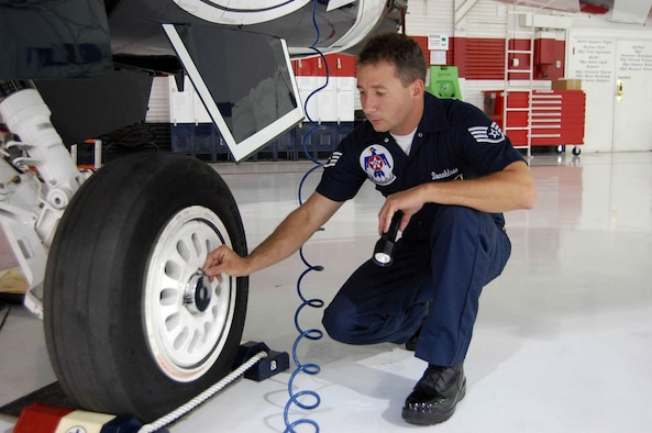 Staff Sergeant Donaldson inspects the wheel and tire assembly on an F-16. (U.S. Air Force Reserve photo/Capt. Jessica Martin)