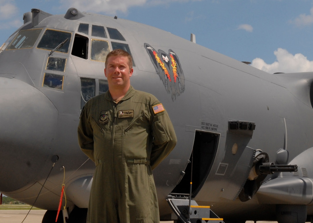 """Tech. Sgt. Corey Fossbender, 4th Special Operations Squadron AC-130U Aerial Gunner and Operations Flight NCO in charge, stands next to an AC-130U gunship at Hurlburt Field flightline July 29, 2010. Sergeant Fossbender was selected for this week's """"Tip of the Spear"""" spotlight. ( DoD photo by U.S. Air Force Staff Sgt. Sarah Martinez)"""