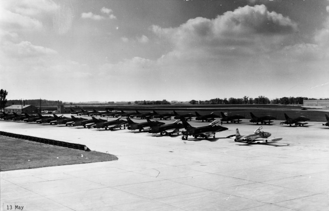 In 1968, several F-100s from the 185th Fighter Wing line up to prepare for a deployment to an unknown location.