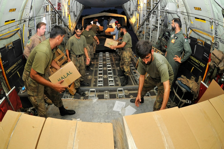 Pakistani Air Force members help unload thousands of Halal meals from a U.S. Air Force C-130H at Peshawar, Pakistan, Aug. 1, 2010. The meals will go to Pakistanis affected by the floods that have devastated the region. The C-130H is assigned to the 455th Air Expeditionary Wing at Bagram Airfield, Afghanistan. (U.S. Air Force photo/Staff Sgt. Christopher Boitz)